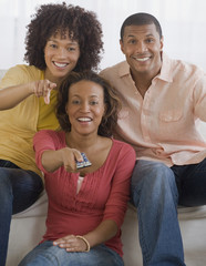 African man and women watching television