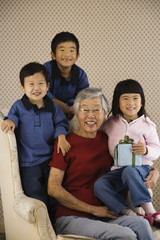 Korean grandmother posing with grandchildren