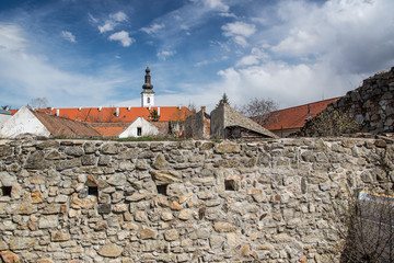 Old city panorama with the stone wall and church