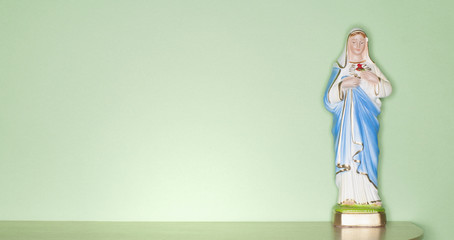 Religious figurine on counter top