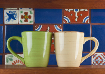 Close up of green and beige mugs