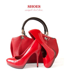Red shoes pair and hand bag isolated on white background