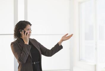 Hispanic businesswoman talking on cell phone