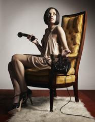 Hispanic woman holding telephone