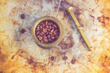 Coffee beans in a bronze mortar