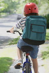 Mixed Race boy riding bicycle