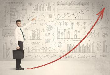 Business man climbing on red graph arrow concept
