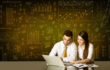 Business couple with diagram background