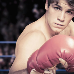 Caucasian boxer with fists raised
