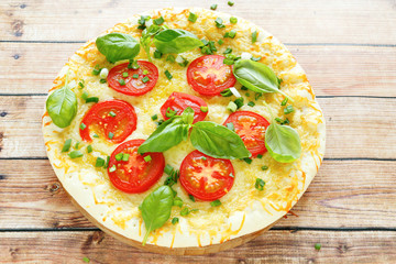 round pizza with mozzarella and tomatoes