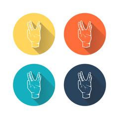 Human hand showing symbol of Vulcan salute.