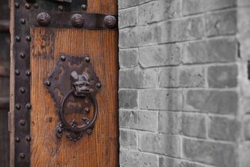 Wooden Door With Ornate Door Knocker