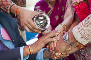 Indian couple performing wedding ceremony