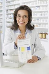 Hispanic pharmacist in filling prescription