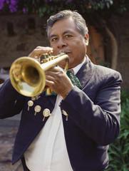 Hispanic man playing trumpet