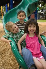 Children sliding in playground