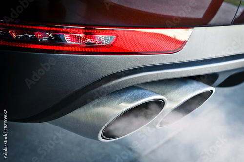 Close up of a car dual exhaust pipe poster