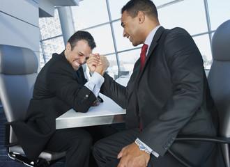 Multi-ethnic businessmen arm wrestling