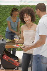 African man and women barbecuing