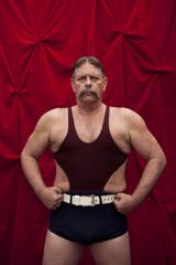 Caucasian weight lifter flexing his muscles