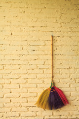 Broom hanging on the wall