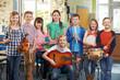 Leinwandbild Motiv Portrait Of Students Playing In School Orchestra Together