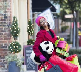 Woman Christmas shopping on city street