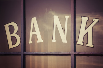 """Close up of """"bank"""" written on window panes"""