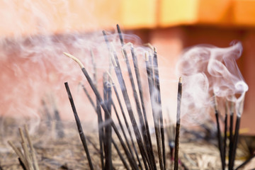 Close up of smoke from incense sticks