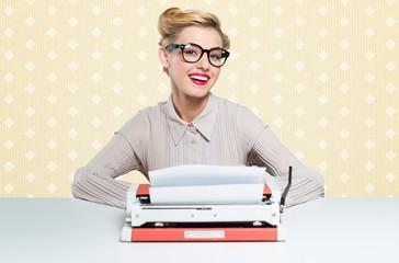 Woman. Beautiful woman writes with a typewriter