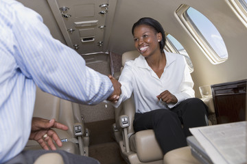 Co-workers having meeting in private jet