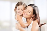 Mother. Family, child and happiness concept - hugging mother and