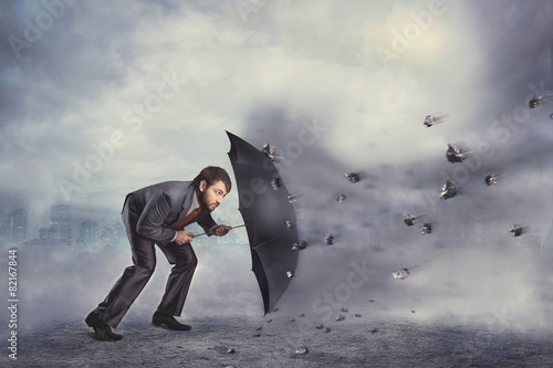 Business man protects himself from the crisis - 82167844