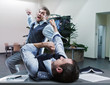 Businessmen fighting in the office - 82168401