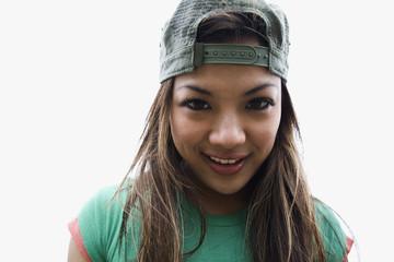 Asian woman posing in backwards cap