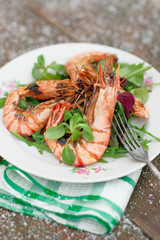 Grilled shrimps served outdoor in winter