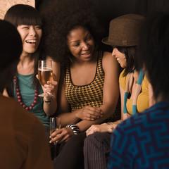 Multi-ethnic friends drinking in nightclub