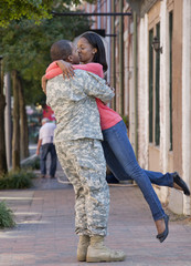 Woman greeting returning soldier