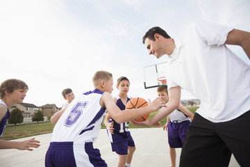 Caucasian basketball team playing on court