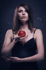 Lonely mad woman with red apple