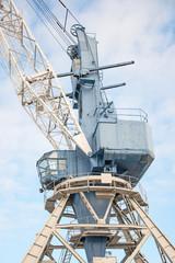 Harbor crane on rails in port.