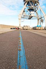 Harbor crane on rails. Focus on rail.