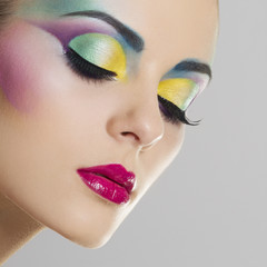 Beautiful woman with bright colourful makeup