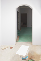 A room with partly installed laminate flooring
