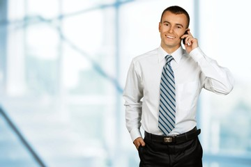 Telephone. Businessman talking on cellphone