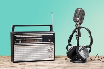 Radio. Retro radio, headphones and microphone old style photo