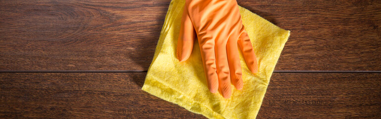 Close-up on hand in glove cleaning