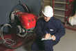 maintenance engineer checking technical data of heating system e - 82175658