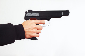 Hand with semi-automatic pistol on a white background