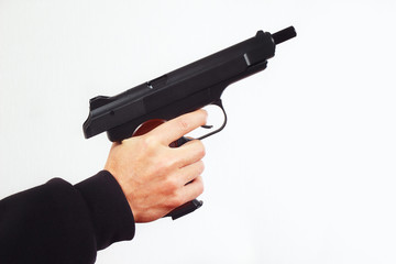 Hand with discharged semi-automatic handgun